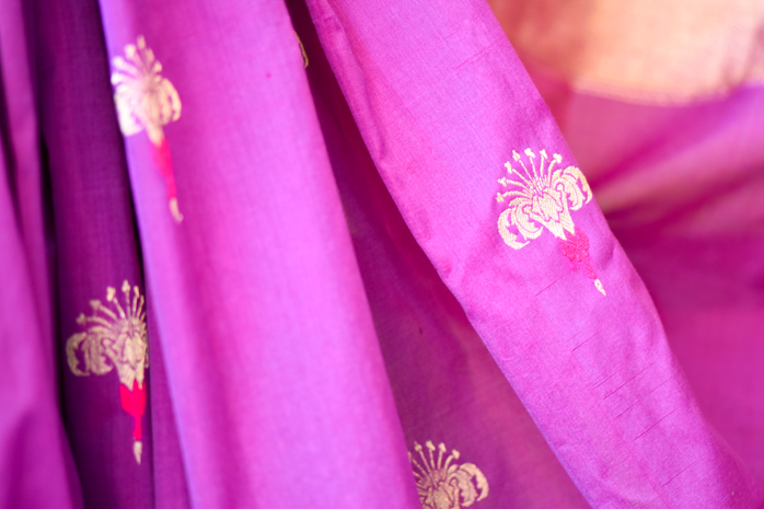The Banarasi Weaves - A 'rani pink' saree with hibiscus motifs.