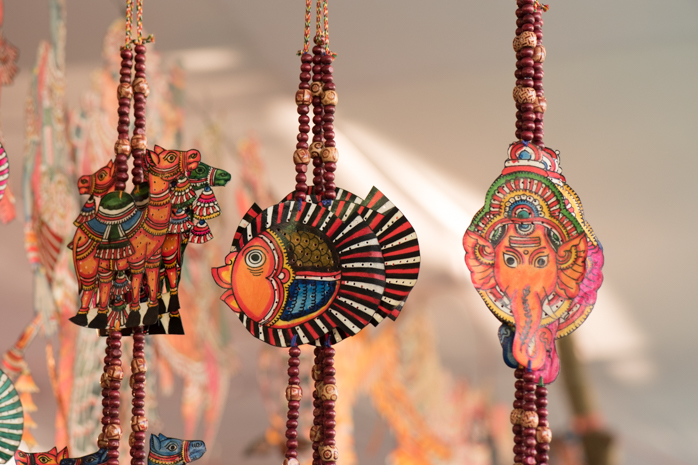 Strings of Door Ornaments, hooked to the sides of doors in India.