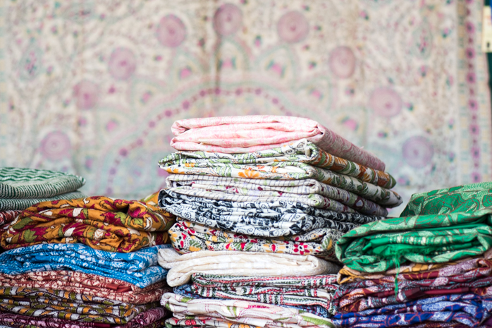 Stacks of sarees in Kantha from West Bengal