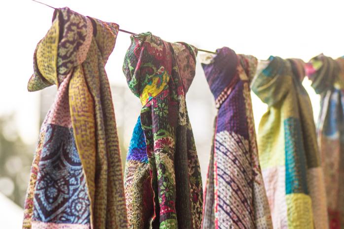 Kantha Dupattas adorn a string line hung outside a stall