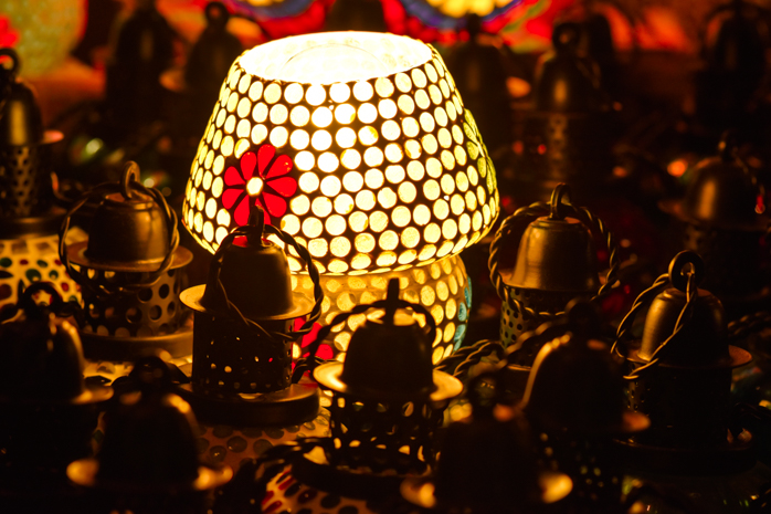 Mosaic glass painted lamps illuminate the night in a magic of colors
