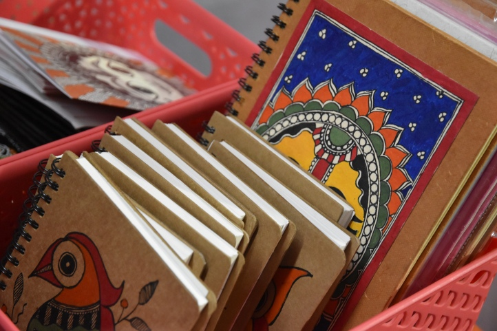 Books with covers in Madhubani paintings