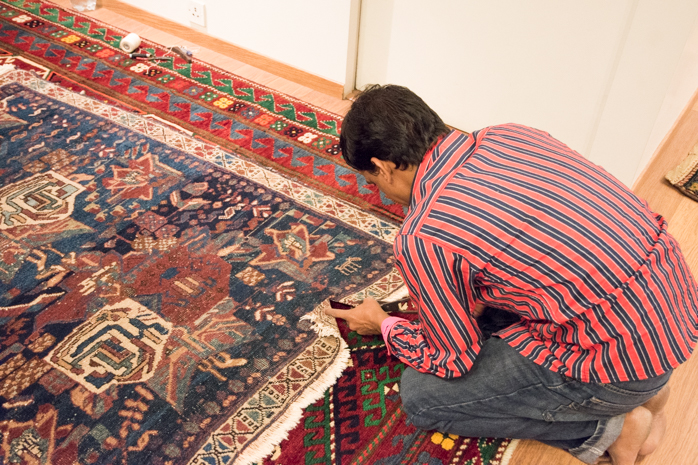 Hussain, who has been working with Danny for three years now, works on flattening the carpet